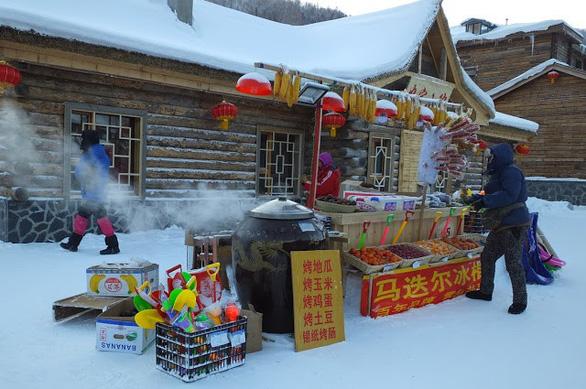 Ngôi làng tuyết trắng đẹp như trong cổ tích ở Cáp Nhĩ Tân - Ảnh 5.