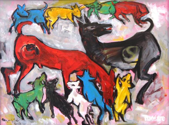 Dễ thương khi họa sĩ Huế vẽ tranh chó nhân năm Mậu Tuất - Ảnh 2.