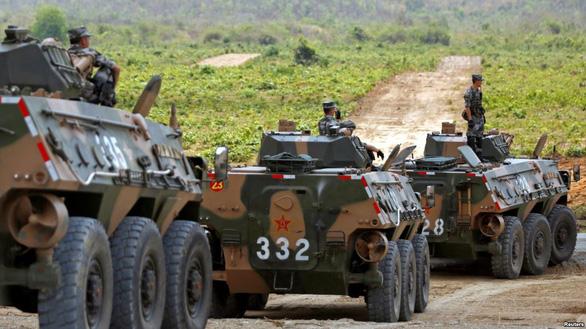 Tập trận 'Rồng vàng' cùng Trung Quốc, Campuchia càng xa Mỹ - Ảnh 2.