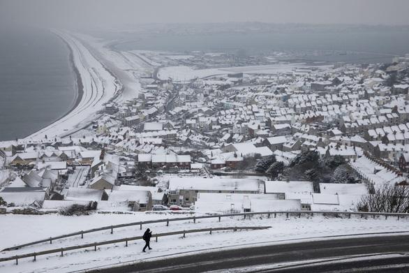 Tuyết rơi mùa xuân ở Anh - Ảnh 7.