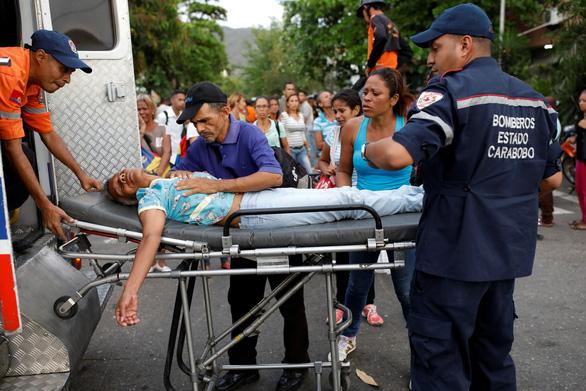 Bạo loạn trong nhà tù tại Venezuela, 68 người chết - Ảnh 5.