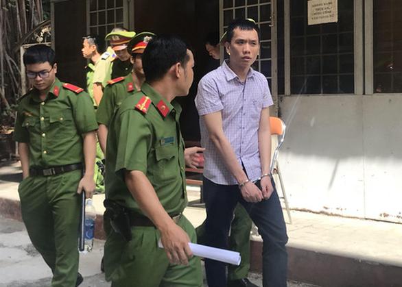 Xét xử cựu công an tội gián điệp, dọa bán tài liệu mật cho nước ngoài - Ảnh 1.