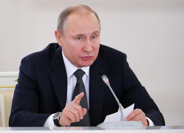 Tổng thống Putin chuẩn bị lò để đốt củi - Ảnh 1.