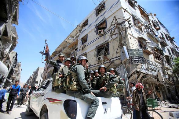 Mỹ tố Nga, Syria xóa dấu vết tấn công hóa học tại Douma - Ảnh 3.