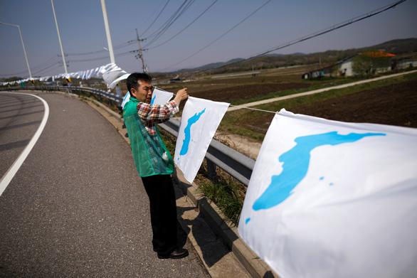 Câu chuyện về lá cờ thống nhất Triều Tiên - Ảnh 2.
