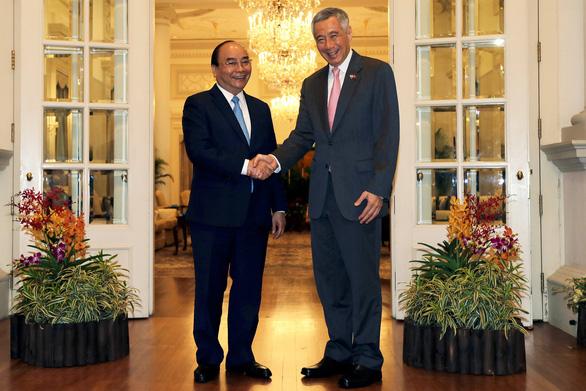 ASEAN sợ hệ lụy từ căng thẳng thương mại Mỹ - Trung - Ảnh 1.