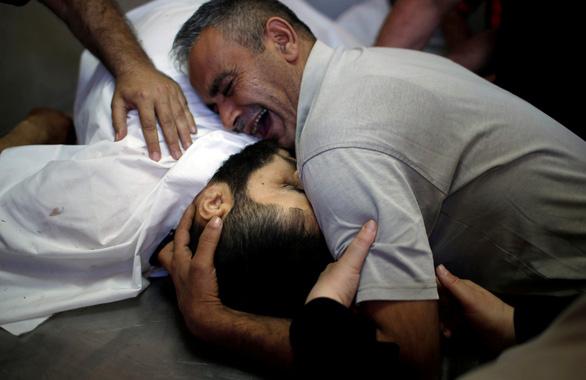 Israel bắn chết 43 người Palestine trong ngày khai trương sứ quán Mỹ - Ảnh 1.