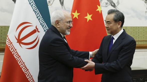 Ngoại trưởng Iran đến Bắc Kinh vận động cứu thỏa thuận hạt nhân - Ảnh 1.