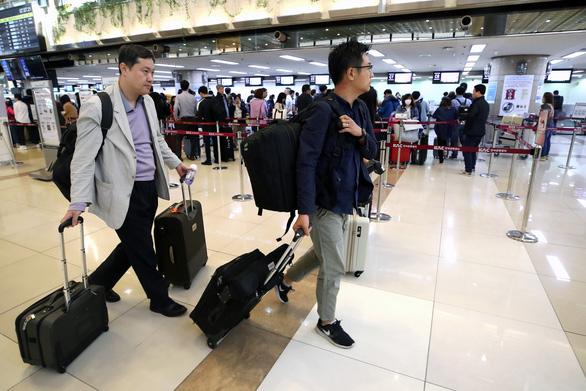 Đoàn nhà báo Hàn Quốc sang Triều Tiên xem hủy bãi thử hạt nhân - Ảnh 1.