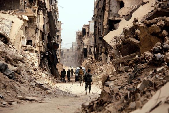 Tổng thống Syria dọa Mỹ nên nhớ 'bài học Iraq' - Ảnh 3.