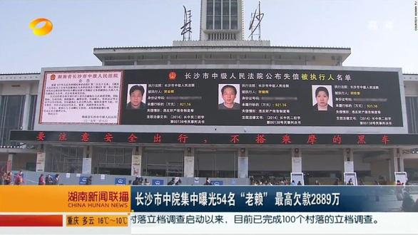 Giựt nợ ở Trung Quốc coi chừng bị bêu tên thị chúng - Ảnh 2.