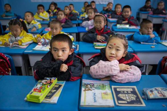 Đối mặt dân số già, Trung Quốc kêu gọi ủng hộ gia đình đông con - Ảnh 2.