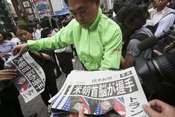 Thế giới kỳ vọng thận trọng về hòa bình sau hội đàm Trump - Kim - Ảnh 1.