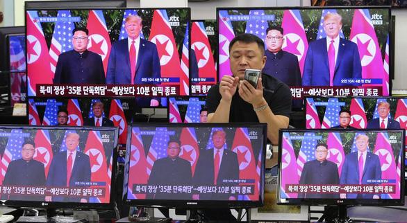 Thế giới kỳ vọng thận trọng về hòa bình sau hội đàm Trump - Kim - Ảnh 2.
