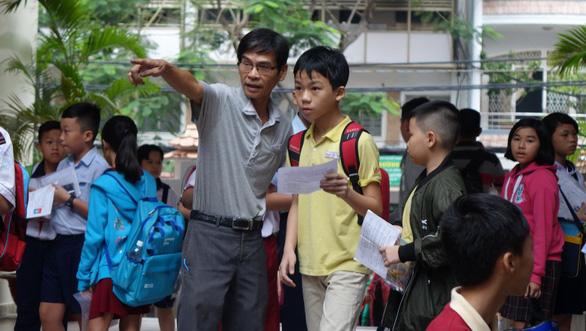 Hơn 4.000 học sinh thi vào lớp 6 Trường Trần Đại Nghĩa - Ảnh 8.