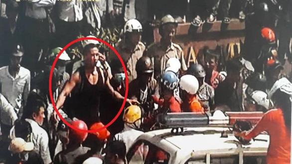 Bắt tạm giam một Việt kiều gây rối tại trung tâm TP.HCM - Ảnh 1.