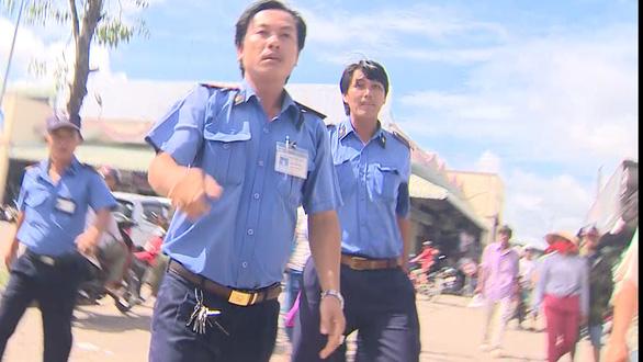 Sẽ chấn chỉnh bảo vệ chợ An Bình cản trở phóng viên VTV - Ảnh 1.