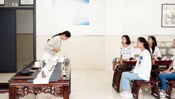 Phụ nữ Trung Quốc luyện công dung ngôn hạnh kỷ nguyên Tập Cận Bình - Ảnh 1.