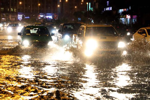 Các bộ phận cần bảo dưỡng trên xe ôtô sau khi đi mưa - Ảnh 1.