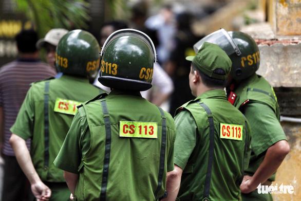 An ninh dày đặc trong buổi tuyên án nhóm khủng bố sân bay Tân Sơn Nhất - Ảnh 9.