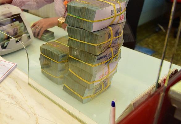 Bộ Tài chính sắp nhận hàng ngàn tỉ đồng cổ tức từ BIDV - Ảnh 1.