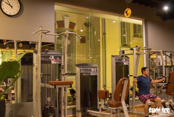 Xả stress, giới trẻ TP.HCM đi tập gym đêm - Ảnh 4.