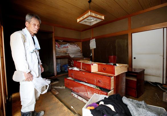 Mưa lũ tại Nhật làm 176 người chết, 50 người mất tích - Ảnh 1.