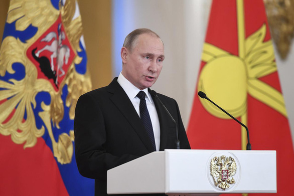 Tổng thống Putin tự hào về các chú gấu Nga dù thất bại ở World Cup - Ảnh 1.