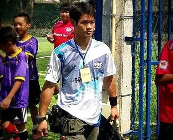 Chân dung 13 thành viên đội bóng mắc kẹt trong hang Tham Luang - Ảnh 14.