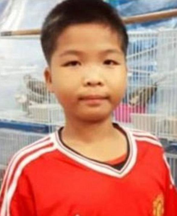 Chân dung 13 thành viên đội bóng mắc kẹt trong hang Tham Luang - Ảnh 11.