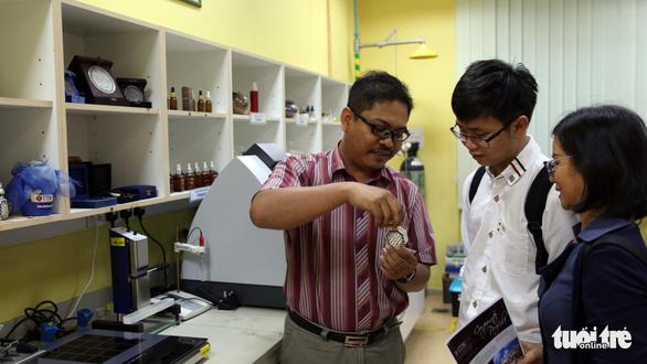 Mở cửa đại học kiểu Malaysia - Ảnh 1.