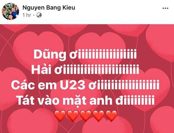 Mỹ Tâm, Đàm Vĩnh Hưng cầm cờ đi bão mừng chiến thắng U-23 VN - Ảnh 17.