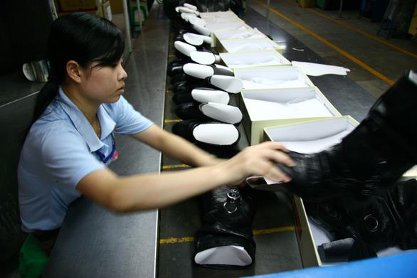 Trung Quốc nhập khẩu từ Việt Nam hơn 1,37 tỉ USD giày dép các loại - Ảnh 1.