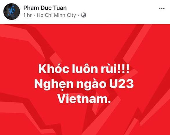 Mỹ Tâm, Đàm Vĩnh Hưng cầm cờ đi bão mừng chiến thắng U-23 VN - Ảnh 18.