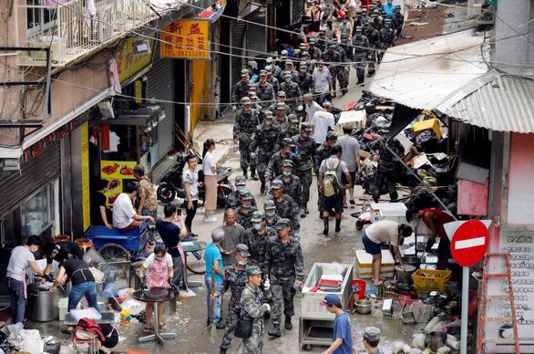 Tại sao Hong Kong đòi dân chủ quyết liệt hơn Macau? - Ảnh 4.