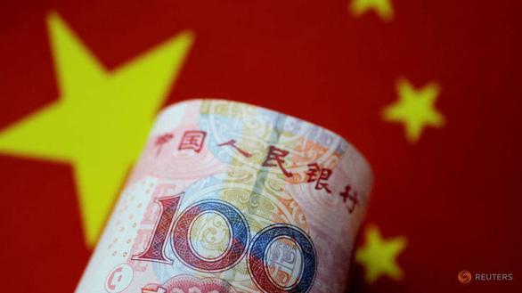 Xuất khẩu, đầu tư ra nước ngoài của Trung Quốc giảm kỷ lục - Ảnh 1.