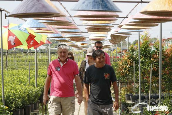 Nhà vườn Sa Đéc đầu tư tiền tỉ cho làng hoa dịp tết - Ảnh 9.