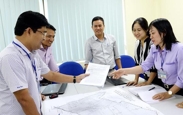 TP.HCM thực hiện cơ chế ủy quyền: Giảm trung gian, tăng hài lòng - Ảnh 1.