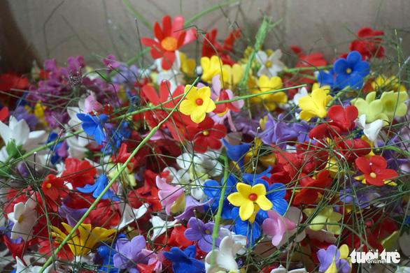 Đất nở hoa trên tay người khuyết tật - Ảnh 11.