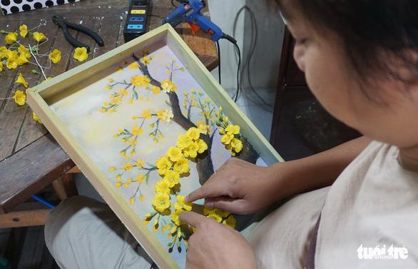 Đất nở hoa trên tay người khuyết tật - Ảnh 13.