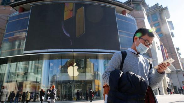 Apple cắt dự báo lợi nhuận quý mới do kinh tế Trung Quốc gặp khó - Ảnh 1.