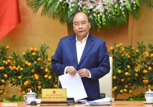 Thủ tướng Nguyễn Xuân Phúc: Trong tháng qua, chúng ta mua trên 4 tỉ USD dự trữ ngoại hối - Ảnh 1.