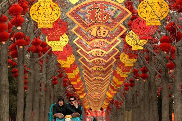 Châu Á thắm xuân, rộn ràng đón Tết Kỷ Hợi - Ảnh 15.