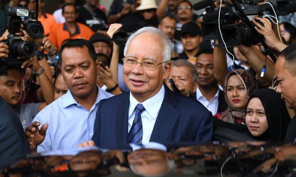 Bắc Kinh bác bỏ thông tin bắt tay ông Najib để được ủng hộ ở Biển Đông - Ảnh 1.