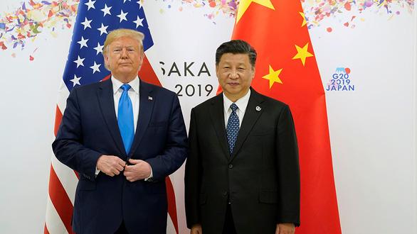 Mỹ - Trung vừa đánh vừa đàm - Ảnh 1.