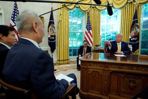 Mỹ-Trung nhất trí thỏa thuận 'giai đoạn 1', ông Trump tạm ngừng tăng phạt thuế - Ảnh 1.