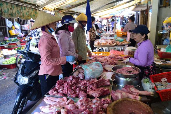 Cần có giải pháp ổn định giá thịt heo - Ảnh 1.
