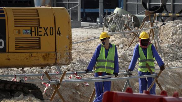 Qatar bãi bỏ các hạn chế liên quan đến lao động nhập cư - Ảnh 1.