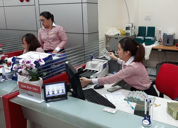 Để TP.HCM thành trung tâm tài chính: Lành mạnh hóa hệ thống ngân hàng - Ảnh 1.