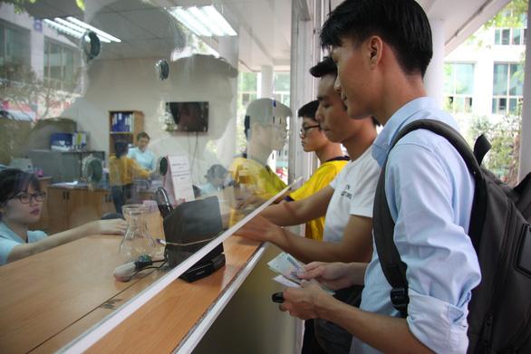 Nợ học phí, sinh viên trường đại học TP.HCM bị hủy kết quả cả học kỳ - Ảnh 1.